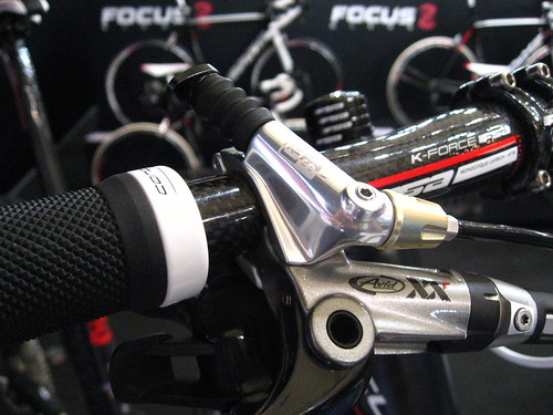 Integrated XX brake lever, shifter, and RockShox lockout button, all on one bar clamp.
