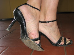hard soles in black sandals (al_garcia) Tags: feet high sandals heels smelly