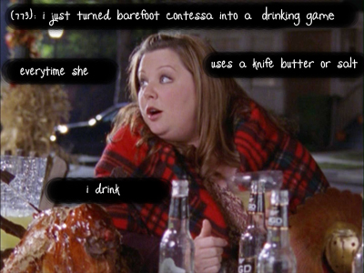 Sookie wears a blanket and holds a bottle of alcohol. The text reads 'I just turned Barefoot Contessa into a drinking game. Every time she uses a knife or butter or salt, I drink.