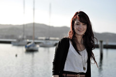 (katierose) Tags: ocean blur water girl smile youth boats happy 50mm harbour young curls hills wellington brunette f18