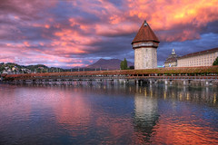 Wasserturm, Lucerne, Switzerland (**Anik Messier**) Tags: sunset sky mountain reflection monument river switzerland europe suisse watertower treasury luzern landmark prison pont lucerne reflets woodenbridge soe wasserturm touristattractions watchtower pinkclouds guildhall chapelbridge kapellbrcke reuss blueribbonwinner torturechamber pontcouvert reussriver mountrigi mywinners anawesomeshot citrit oldestwoodenbridgeineurope theperfectphotographer