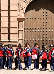 IMG_6202-ST (dojoklo) Tags: door plaza wood trip blue school boy red peru church southamerica girl vertical cuzco architecture kids children wooden kid uniform child cathedral cusco row class line fieldtrip schoolkids plazadearmas vivatravelguides vivatravelguidescuscoandmachupicchu vivatravelguide