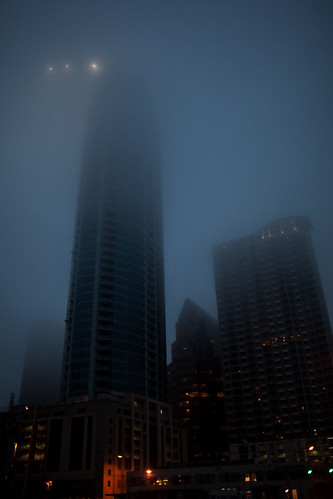 the austonian and frost tower under construction in the fog