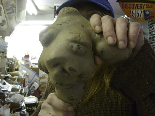 Janice wears the potato mask at Everybody's Market