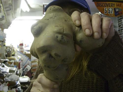 Janice wears the potato mask at Everybody's Market