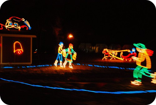Christmas lights, ice skaters.