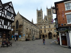 Lincoln Cathedral and the Parish Church of St Mary Magdalene with St Paul in the Bail and St Michael on the Mount (woodytyke) Tags: county street door old city uk wedding red england dog house brick tower castle english history church public leather st parish festival shop architecture yard bag square jack paul photography michael town photo pub arch with cathedral britain sale timber flag united mary hill union kingdom sone tourist cobbled historic mount half lincoln british cobbles minster information handbag isles carta bail steep magna radley timbered magdalene marstons vistor lincolshire exchequergate bailgate woodytyke 2011lincolnmillwall15may