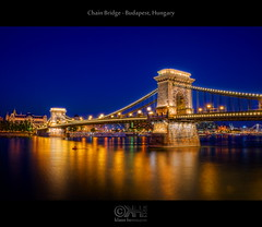 Chain Bridge - Budapest, Hungary (HDR) (farbspiel) Tags: travel tourism night photoshop reflections river geotagged lowlight nikon hungary tripod budapest wideangle fave journey bluehour nikkor dri danube hun hdr attraction watermark hdri topaz donau adjust infocus chainbridge postprocessing 18200mm photomatix tonemapped tonemapping denoise watermarking d7000 topazsoftware nikonafsdxnikkor18200mm13556gedvr geo:lat=4749911538 geo:lon=1904108763