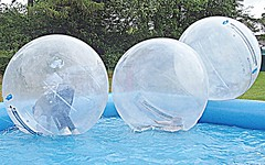 Water balling at the Country Fest (Tony Worrall Foto) Tags: show england wet water pool festival kids fun big balls move cumbria round inside splash float spherical waterball kendal 2011 sphereing countryfest orbing globeriding