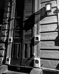 Door to NOLA (El Cheech) Tags: doorway wood bourbonst bourbon bourbonstreet creole french frenchquarter historic history nightshot gaslamp shadow shutter blackandwhitephotography photography blackandwhite door louisiana neworleans nola