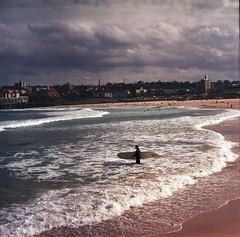 fool that i am (hurtingbombz) Tags: 120 6x6 clouds waves kodak tl surfer tide sydney overcast australia mf 160vc portra bondibeach f28 80mm pentaconsix carlzeissjena kulashaker biometar
