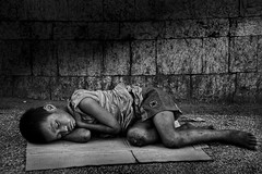 Cebu City - 6.31am (Mio Cade) Tags: poverty road street city morning travel boy cold boys kids neglect children kid bed asia alone path sleep walk philippines neglected dirty beggar busy parent cebu lonely streetchildren passerby beg atrisk savethechildren blueribbonwinner cebusugbo flickraward earthasia