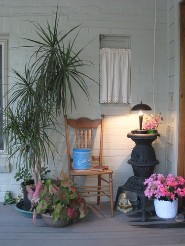 A cute front porch vignette with lamp and stove, via Flickr: anne_dillingham