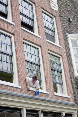 man painting Noordmarkt Amsterdam
