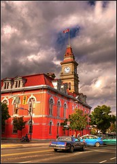 City Hall (Brandon Godfrey) Tags: world pictures street old city autumn trees windows red urban canada building tower fall clock st vancouver clouds buildings landscape island photography hall amazing scenery downtown bc shot traffic photos shots pics cityhall earth britishcolumbia flag cab sony capital overcast scene columbia victoria canadian clocktower vancouverisland creativecommons western motorcycle pacificnorthwest northamerica driver british bluebird douglas pandora lowrider 2009 hdr highdynamicrange daytons a300 photomatix tonemapped tonemapping sonya300 80scutlass