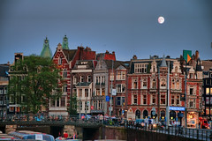 Housing in Amsterdam (Werner Kunz) Tags: world city trip travel vacation urban moon house holiday holland building tower church dutch amsterdam skyline photoshop town cozy nikon downtown cityscape place townhouse wideangle netherland 40 lovely sidebyside narrow dri hdr hdri werner niederlande gracht skyscrapper kunz photomatix 20fav explored colorefex amsetrdam nikond90 niderlande topazadjust werkunz1