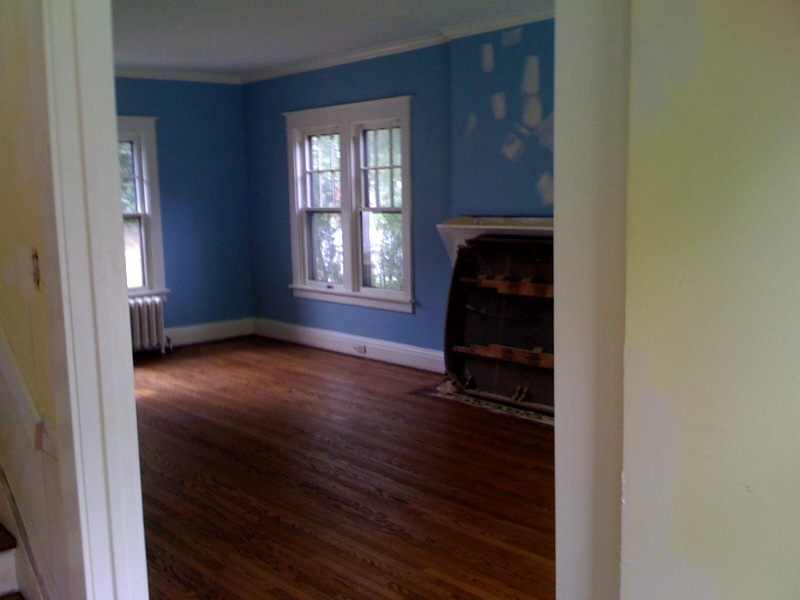 Living room with new stain on floors