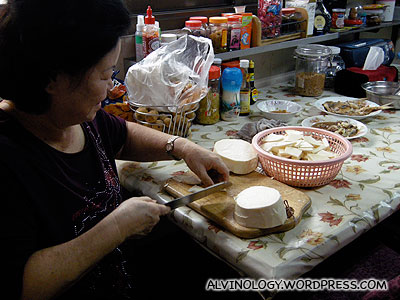 The housekeeper/cook chopping up the bamboo shoots for lunch