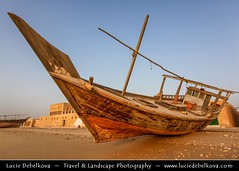 Qatar - Early Morning at Al Wakra and its Dhows (Boats) ( Lucie Debelkova / www.luciedebelkova.com) Tags: ocean street city morning travel blue sea summer vacation sky urban panorama house holiday tourism beach water architecture sailboat landscape boats outdoors harbor boat town casa fishing arquitectura sailing ship cityscape view artistic traditional cit sails scenic middleeast haus vessel structure shore transportation arabia sail vista architektur historical exploration landschaft architettura ville gcc architectuur qatar dhow urbain harber wakrah alwakrah wagrah luciedebelkova alwaqra alwaqrah wwwluciedebelkovacom