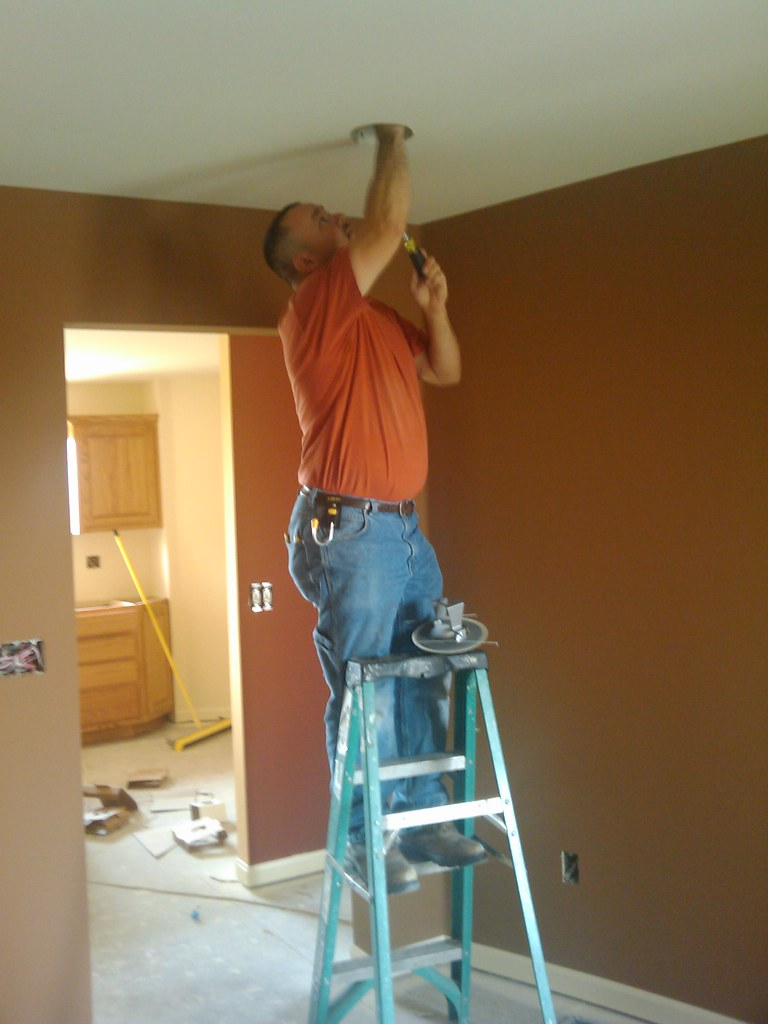 Chad installing a ceiling can
