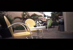 lounge area (abdukted1456) Tags: panorama 35mm cafe chairs florida empty pano toycamera melbourne panoramic fl widepic fauxpanorama fakepanorama drugstorefilm