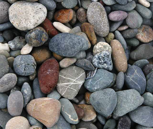 Rocks on the beach in Bandon Oregon by Faye Pekas