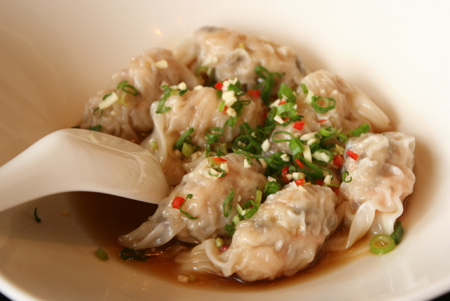 Poached Beijing dumplings stuffed with chicken and prawns in chili vinegar sauce (S$4.20 for 3 pieces)
