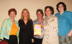 Kathryn Stockett (in black) surrounded by libr...