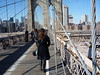 Kate walks the footbridge to Manhattan