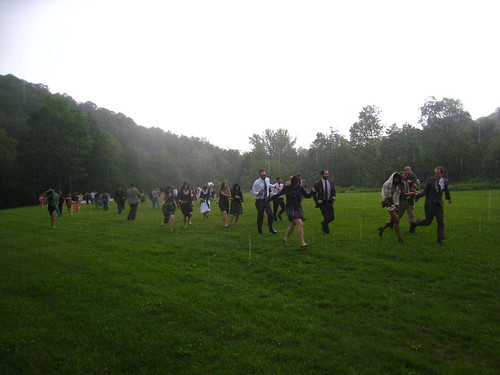 the wedding attendees running for cover