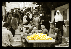 Selling Yellow (iGabi~) Tags: yellow israel blackwhite lemon jerusalem arab vendor oldcity selectivecolor palestinian damascusgate