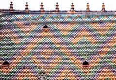 Church roof (Gerlinde Hofmann) Tags: germany thuringia town meiningen church roof pattern fishscalepattern shingle tile rooftop dach dachziegel rooftile dachschindel beavertailshaped historismus historicism fischschuppenmuster eklektizismus eclecticism gründerzeit finial resembling ähnlich