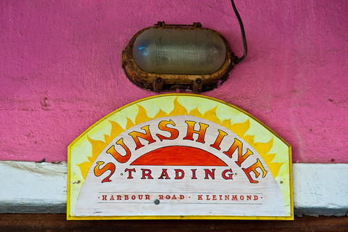 Sign and light above door of Sunshine Trading in Kleinmond