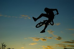 Sunset Jump (Harry-Harrison) Tags: uk blue shadow sky sun field bike bicycle silhouette set clouds coast jump strawberry bmx air norfolk trails 360 dirt fields trick jumps