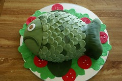 Fogerty The Fish cake! ({ coco cake cupcakes }) Tags: crazycake fishcake greenfish cococake noveltycake cartooncake sculptedcake cococakecupcakes cakevancouver fondantfishcake fishonaplatter