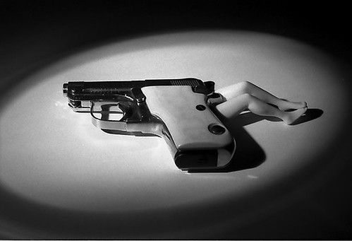 laurie simmons lying gun