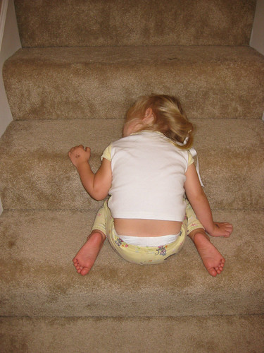 Micah asleep on the stairs, again