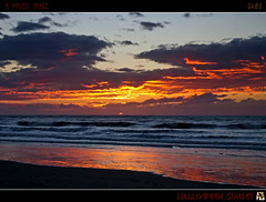 Halloween Sunset (tomraven) Tags: sunset red sea sky orange sun halloween clouds reflections geotagged surf waves oct31 betterthangood fbdg tomraven capturethefinest q409 geo:lon=175116577 aravenimage geo:lat=40735681