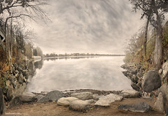 Stones are Immortal (Ben Heine) Tags: trees light wild white canada reflection nature sepia clouds composition island nikon dof time cloudy quebec pov stones lumire pierre montreal branches horizon perspective traces amphibian pebbles rivire clean clear reflet arbres harmony reflejo photomontage through pierres temps past pure saintlaurent forests pinetrees transparence eternal immortality fleuve aquaticlife galets saintlawrence warmcolors sainthilaire richelieuriver benheine stonesareimmortal