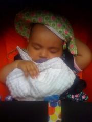 Laila asleep in the stroller