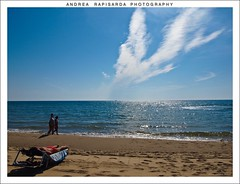 relaxing  at  the beach (Andrea Rapisarda) Tags: blue summer vacation sky italy sun beach nature clouds relax geotagged sand italia nuvole estate playa natura olympus sicily sole catania sicilia notripod vacanze sabbia lacucaracha nohdr straightfrommycamera fourthird quattroterzi rapis60 andrearapisarda olympuse620 veryminimalediting geo:lat=37454907 geo:lon=15085972 laplayadicatania