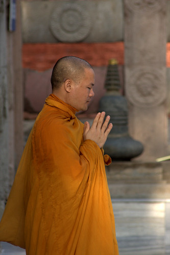 A Buddhist Monk Prays At Mahabodhi Temple