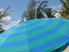 bikini beach number 1 (sidemtess   linda) Tags: ocean vacation sky beach umbrella french island saintmartin waves stmartin stmaarten 2009 orientbeach saintmaarten frenchwestindies bikinibeach sooc lhoste lhostehotel sidemtess