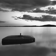 Untitled (KP Wilkman) Tags: sea bw cloud white black reflection water rock night clouds reflections long exposure pentax dreamy k20d pentaxk20d