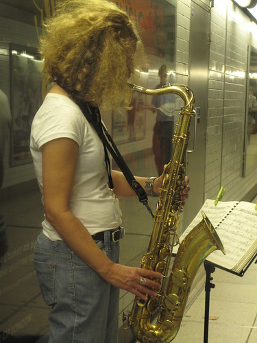 A lady busking in a London underground station