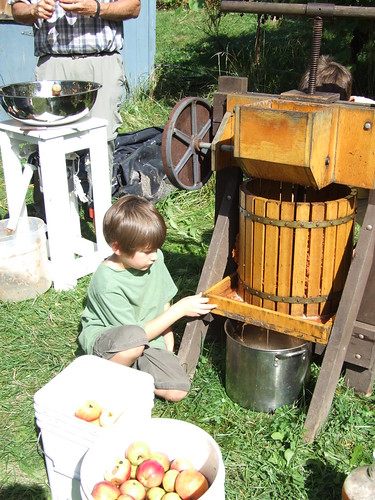 watching the cider pour from the press