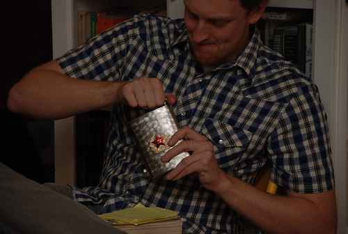 opening the flask filled with Dickel that had been buried in his parents' yard (or something similar) for fifteen years