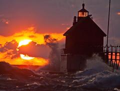 Splash at Sunset (Mi Bob) Tags: sunset lighthouse waves lakemichigan grandhaven grandhavenstatepark llmsmigrandhaven