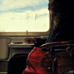 Crosswords Train / Cruciverba (Osvaldo_Zoom) Tags: railroad travel red italy woman train canon project bag profile journey calabria commuters trenitalia crosswords g7 cruciverba
