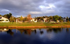 Eastern shore and private homes- View large!!! (Chris C. Crowley) Tags: park houses lake water clouds scenic reflectiion centralflorida cooloutdoorpics suberbs chriscrowley cloudsandanythingelse onlythebestare finefind reedcanalpark celticsong22 yourfriendlyneighborhoodpark southdaytonafl easternshoteandprivatehomes